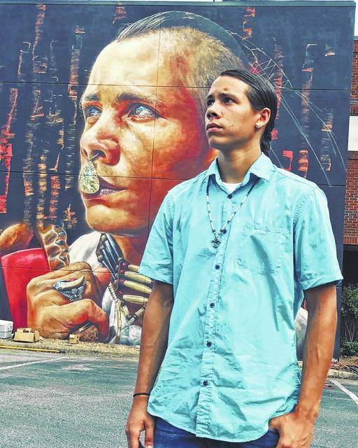 Murals in Greensboro feature images of Lumbee Tribe members